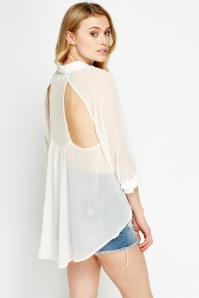 Cut Out Back Dip Hem Blouse