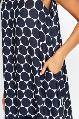 Circle Print Dip Hem Top