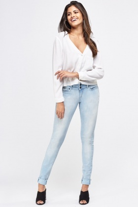 Twin Button Front Skinny Jeans