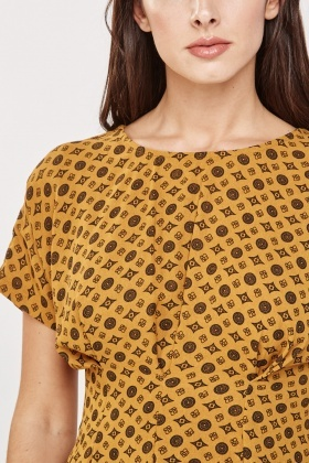 Printed Pleated Peplum Top