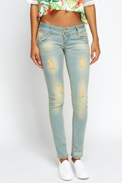 Washed Out Skinny Frayed Jeans