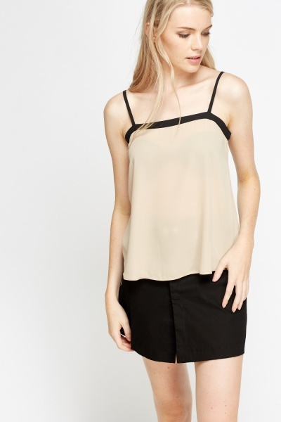Try a comfortable cami top under a blouse or opt for a lace camisole with pretty accents that peek out from your v-neck top. You can even match your camisole to your panties for seamless style. With a variety of different lengths and colors, you can find a fitting slip for under any item of clothing.
