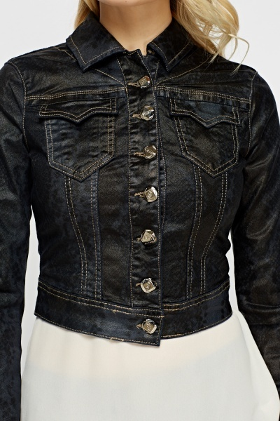 Waxed denim, where denim is finished with a coating that resembles candle wax, has been popular for a few seasons. The textural effect is stiff, rubbery and quite shiny in an interesting matte way.