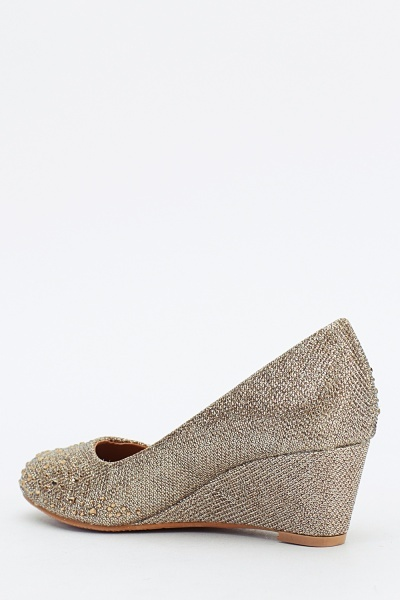 Encrusted Metallic Wedge