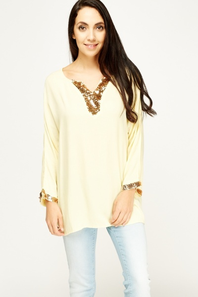 Sequin Trim Dip Hem Top