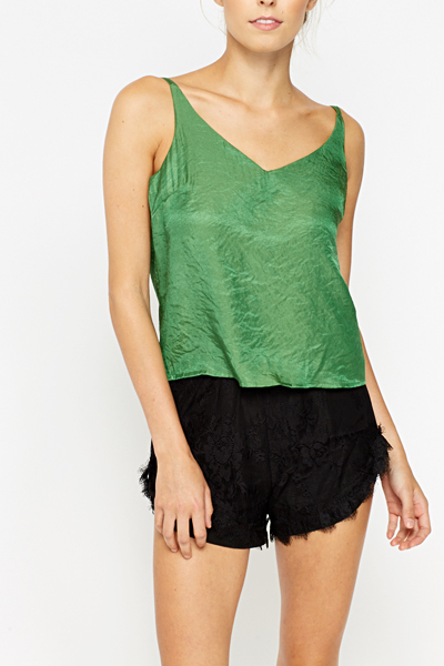 Slip on the Ekria Dark Green Cami Top for an easy-going yet chic OOTD! This versatile cami top, composed of a sleek and soft woven fabric, features a V-neck and triangle bodice with a 5/5(2).