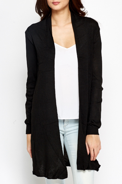 A cool-weather layer you'll reach for time and time again, this soft cardigan features a open-front silhouette, long sleeves, and longline silhouette. - Also available in other colors Side pockets81% rayon.