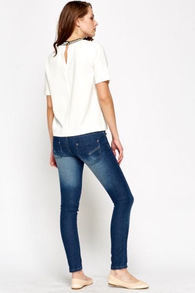 Twin Button Skinny Jeans