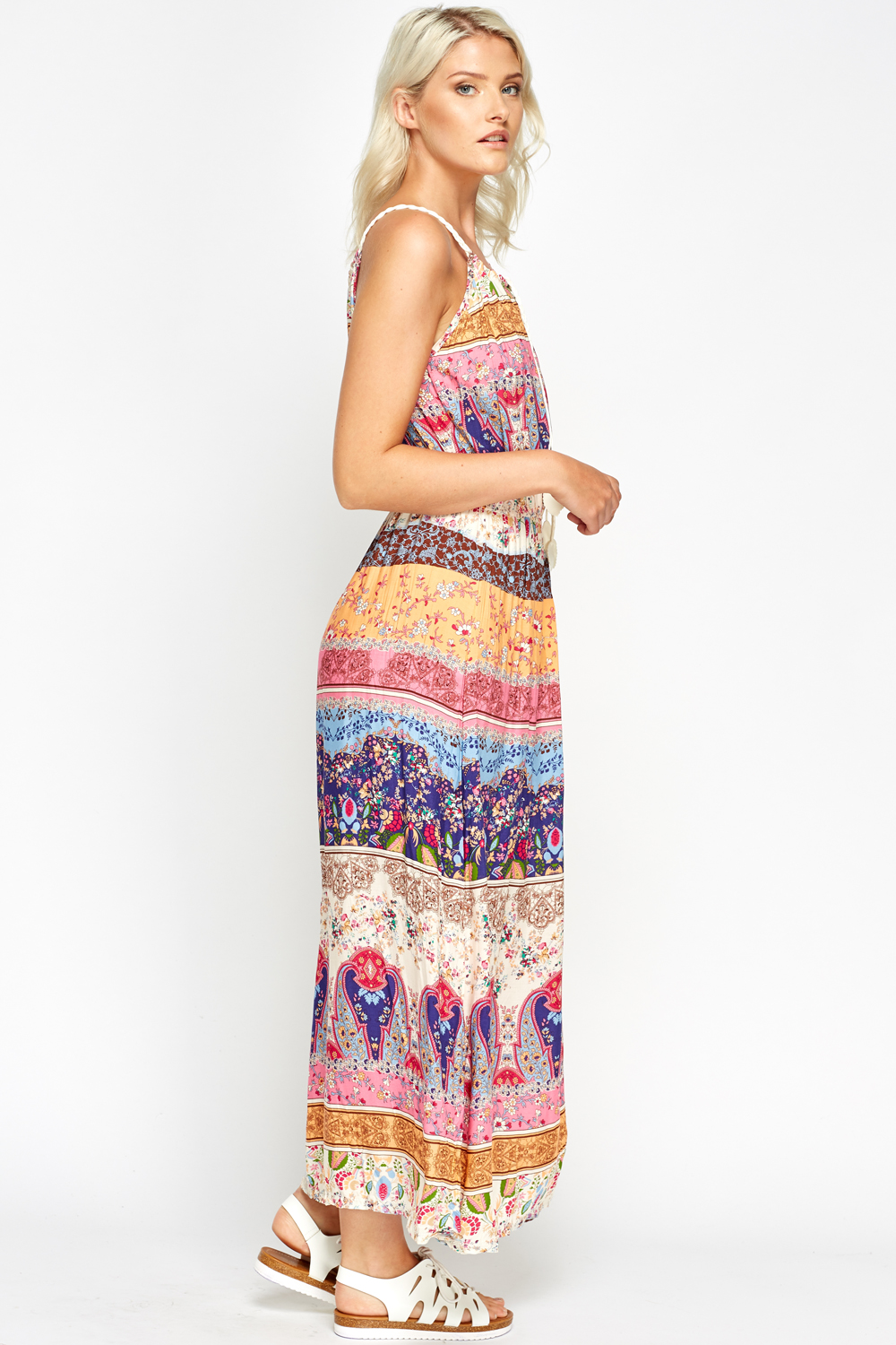 Tiered maxi dress has a tropical print and drawstring waist for a flattering fit. Gentle wash. Imported. Navy.